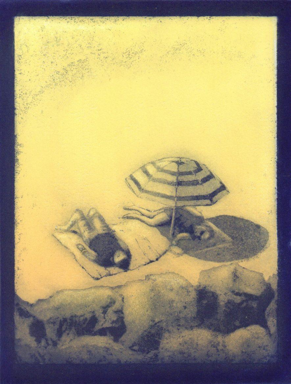 Beach Sun bathers under umbrella